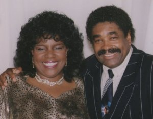 Gloria didn't know how to tell George (off of George McCrae) that most of his eyebrows had fallen onto his top lip