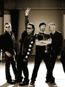Bono puts his hand up to attract the teachers attention as he desperately needs to pee