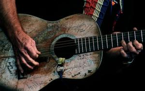 This is Willie Nelson's guitar, affectionately known as Trigger. It sure has been used!