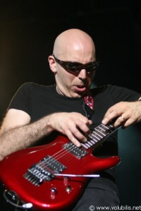 Joe was very proud of his acheivement of knitting himself a new guitar with those magic invisible knitting needles