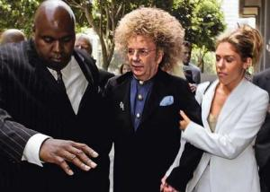 Phil Spector's attempt to escape custody while disguised as a toilet brushed failed abysmally