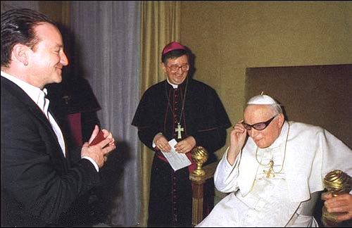 Pope steals Bono's glasses in effort to look cool........ FAILS!