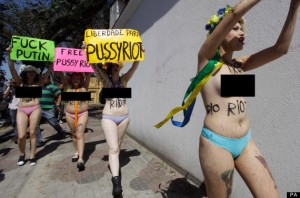 I'm not sure where this picture was taken but the green placard says it all for me! FUCK PUTIN!